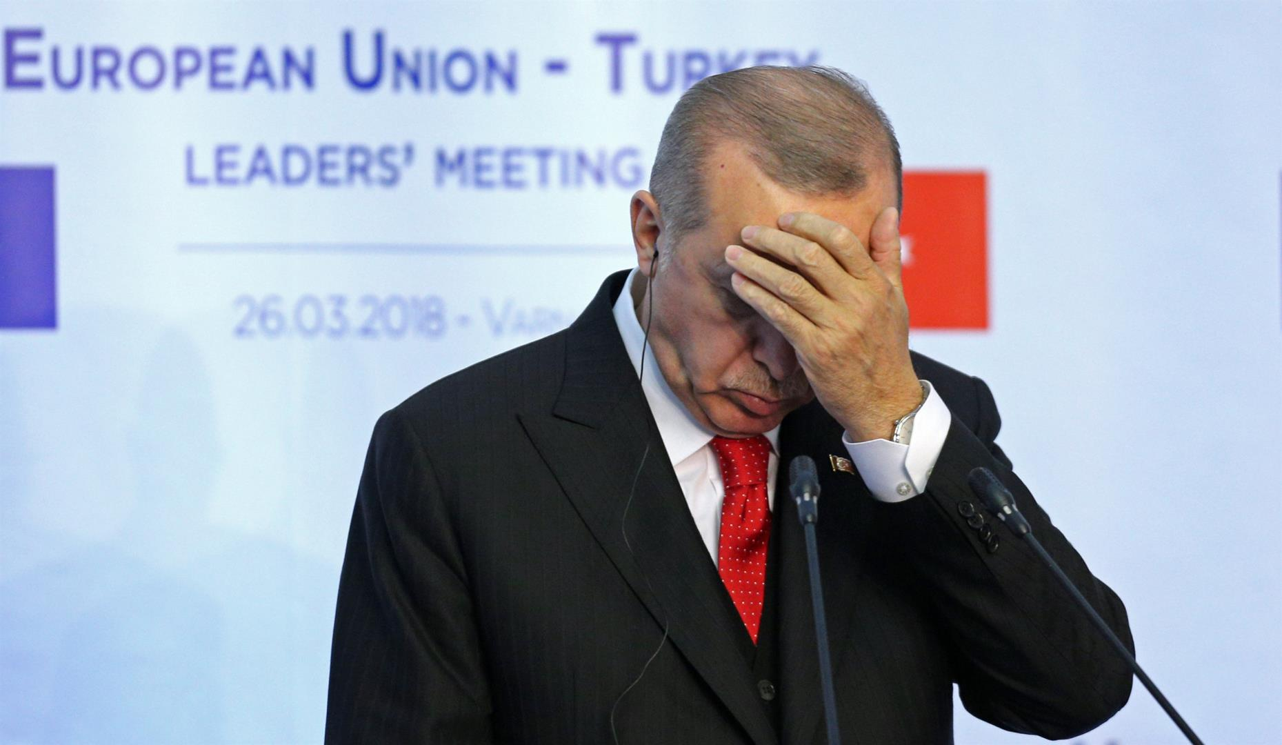 Turkish President Tayyip Erdogan reacts during a news conference at Euxinograd residence, near Varna